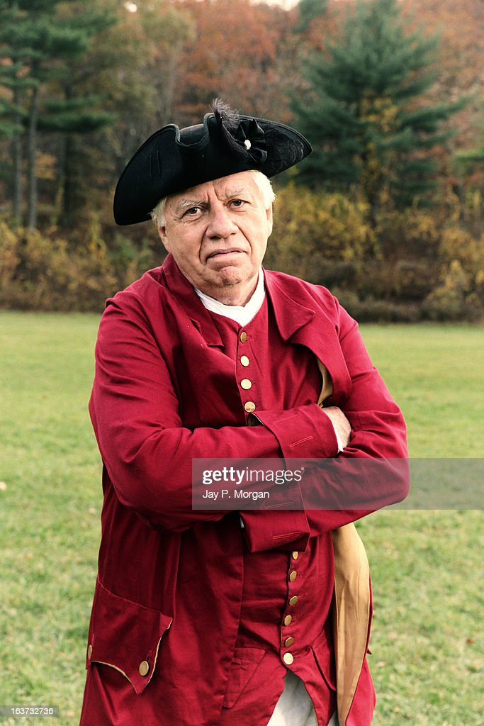 Colonial old man in period clothes