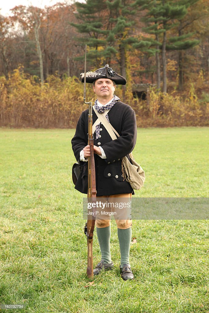 Colonial soldier poses with rifle