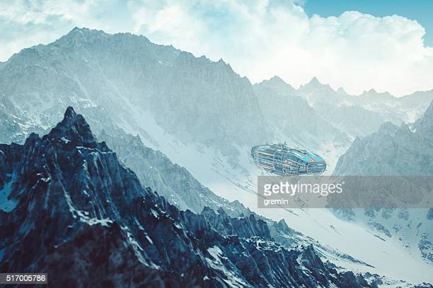 Colonization mothership flying low between alien mountain peaks