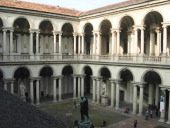 CONTENT] Colonnade and statue in the internal courtyard of the art gallery called Brera in the city centre of Milan