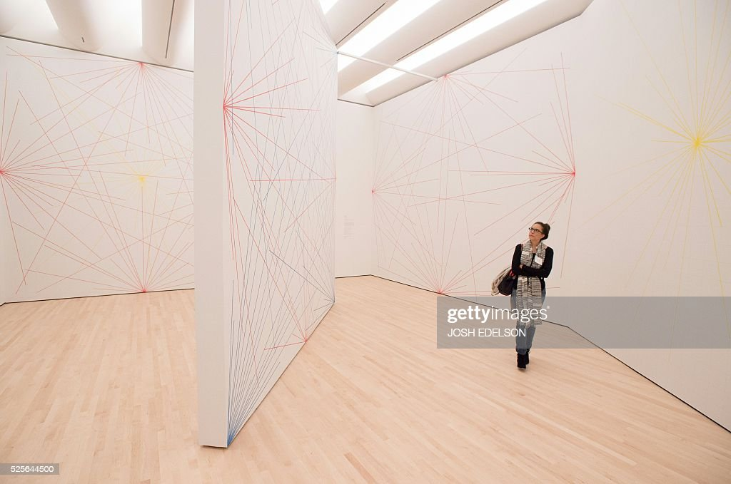 Colony Little looks at an art piece entitled 'Wall Drawings 273' inside the San Francisco Museum of Modern Art (SFMOMA) in San Francisco, California on April 28, 2016. . The newly redesigned museum integrates a 10-story expansion in a new building and will open to the public on May 14, 2016. / AFP / Josh Edelson / RESTRICTED