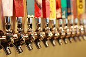 row of color full beer taps