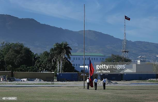 A color guard raises the Haitian flag in front of the what was once the Presidential Palace before it was destroyed when a magnitude 70 earthquake...