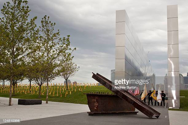 A color guard stands inside the Empty Sky Memorial structure during the structure's dedication at Liberty State Park on September 10 2011 in Jersey...