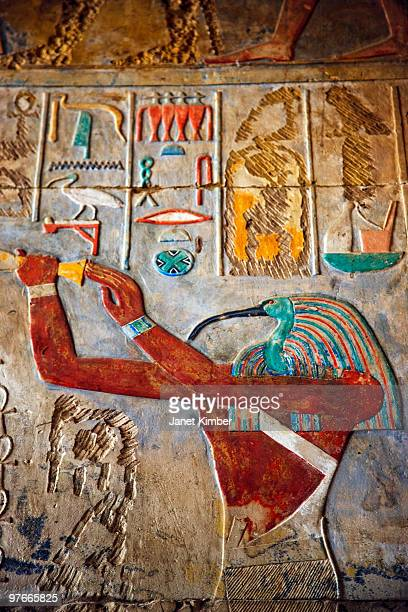 Color hieroglyphics and carvings.
