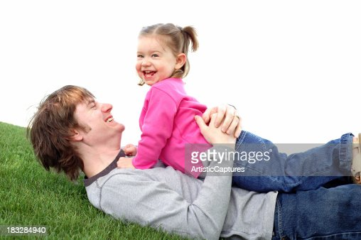 Color Image of Daddy & Daughter Laughing Together Outside : Stock Photo