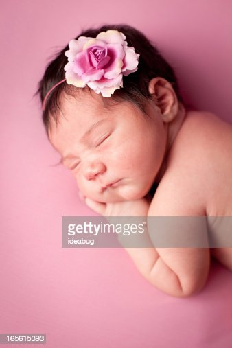 Color Image of Precious Newborn Baby Girl on Pink Background : Stock Photo