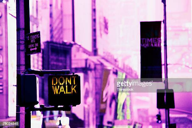 Color infrared pink tone of a DON'T WALK sign in Times Square, New York City.