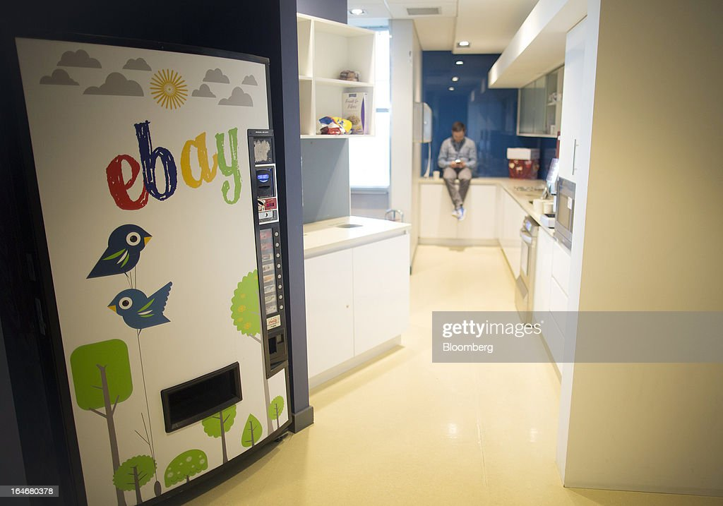 A color mural for EBay sits on the front of a vending machine inside the staff canteen at EBay Inc.'s European headquarters at Blanchardstown in Dublin, Ireland, on Friday, March 15, 2013. Ireland's renewed competiveness makes it a beacon for the U.S. companies such as EBay, Google Inc. and Facebook Inc., which have expanded their operations in the country over the past two years. Photographer: Simon Dawson/Bloomberg via Getty Images