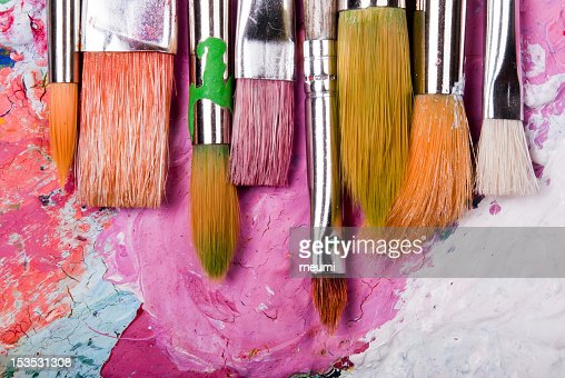 A color paint palette and paintbrushes : Stock Photo