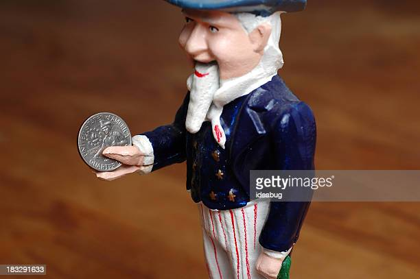 Color Photo of Vintage Metal Uncle Sam Bank Holding Quarter