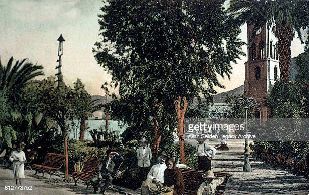 Color postcard of park with visitors in Guatmas Cuba circa 1915