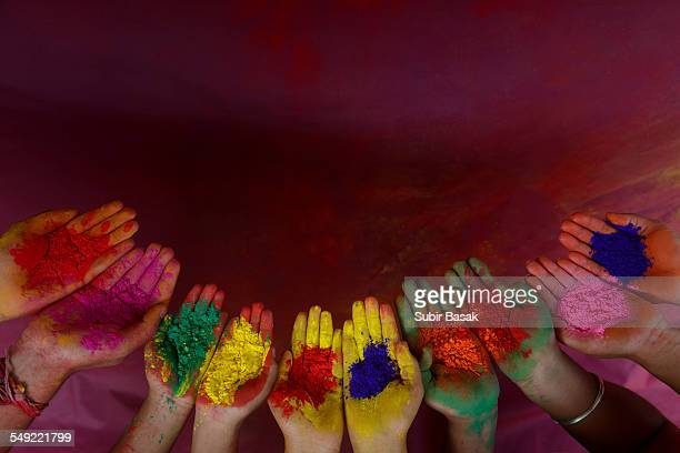 Color powder on hands during Holi festival, India