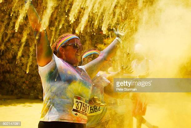 Color Run competitor celebrating.