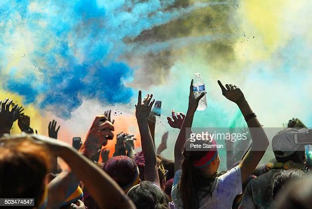 Color Run participants celebrating.