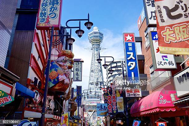 Color signs and Tsutenkaku Tower in south Osaka