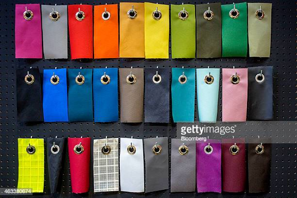 Color swatches for custom made bags hang on a wall at the Timbuk2 Design Inc manufacturing facility in San Francisco California US on Friday Feb 13...