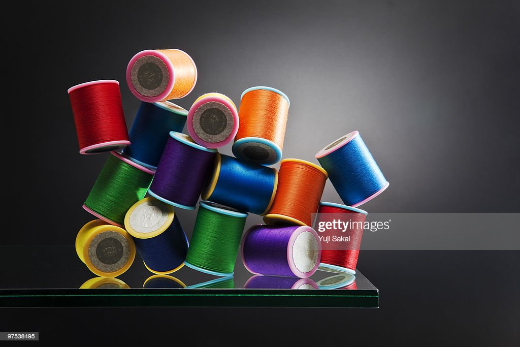 color thread  on glass board : Stock Photo