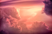 Colorful clouds on the dramatic sunset sky, Color toned image,Dramatic sunset sky with colorful clouds.