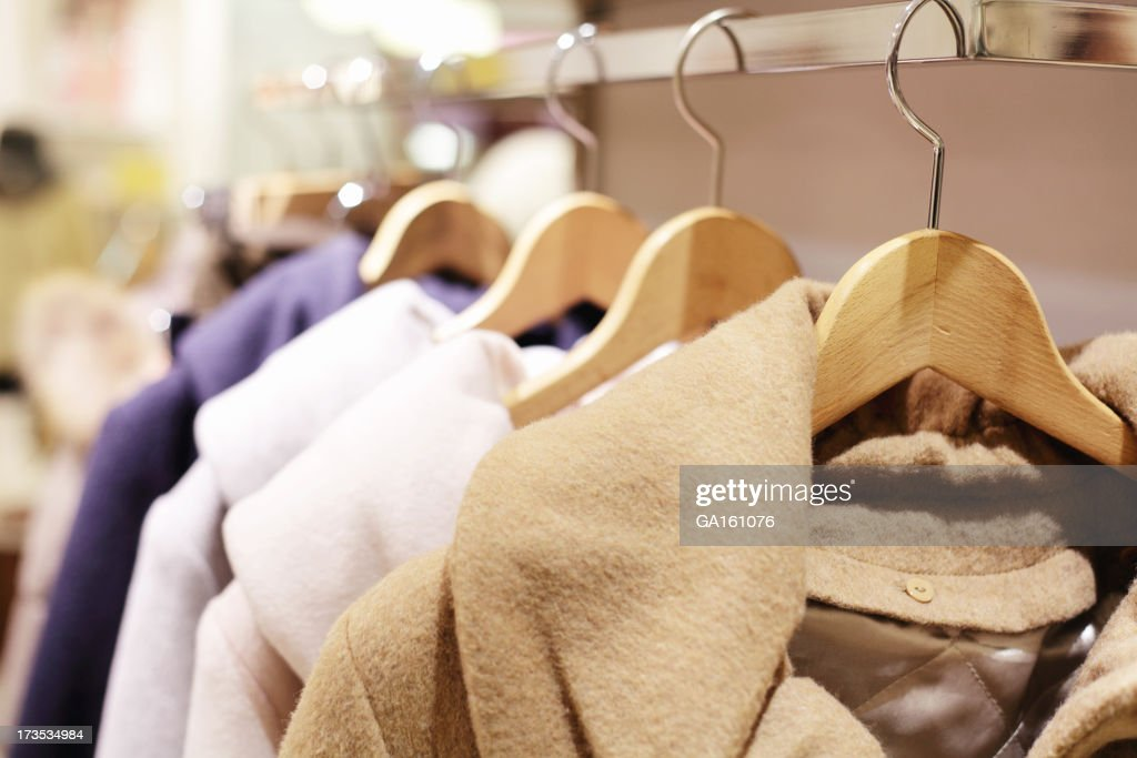 Color winter coats hanging on the rack