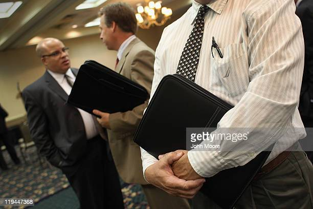 Coloradans wait to meet potential employers at a sales and management career fair on July 20 2011 in Westminster Colorado The job fair organized by...