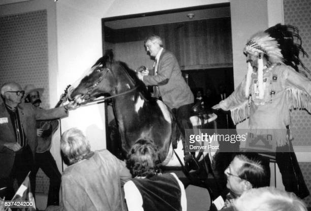 Colorado Adjutant General John LFrance hangs on to a registered paint horse named Gillian at the 1989 Citizens of the West award dinner Monday at the...