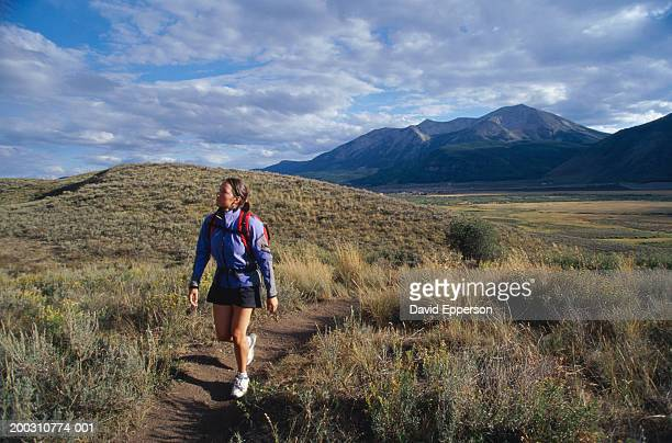 USA, Colorado, Aspen, Crested Butte, young woman hiking on trail