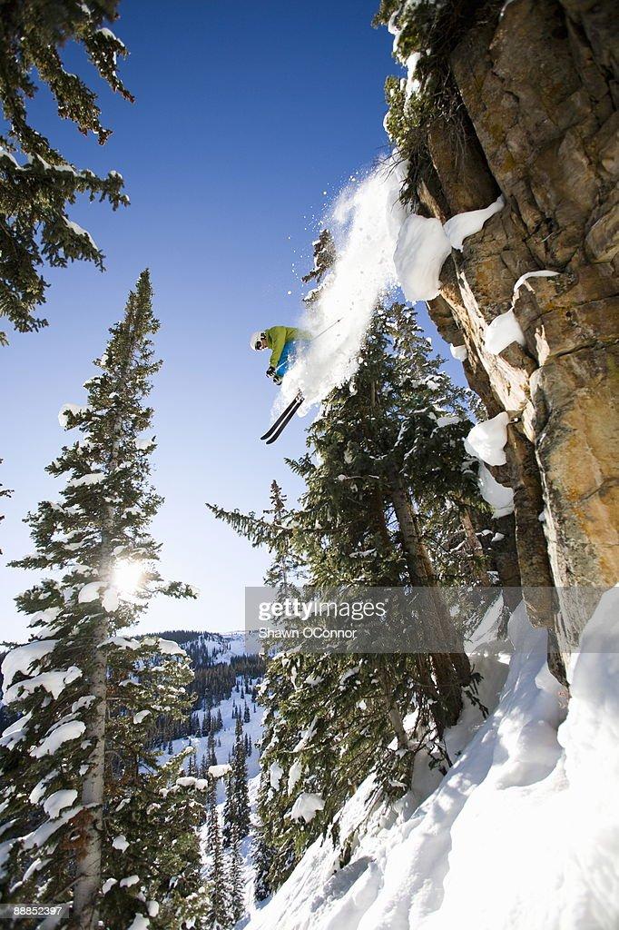 USA, Colorado, Aspen Snowmass, Skier jumping off cliff
