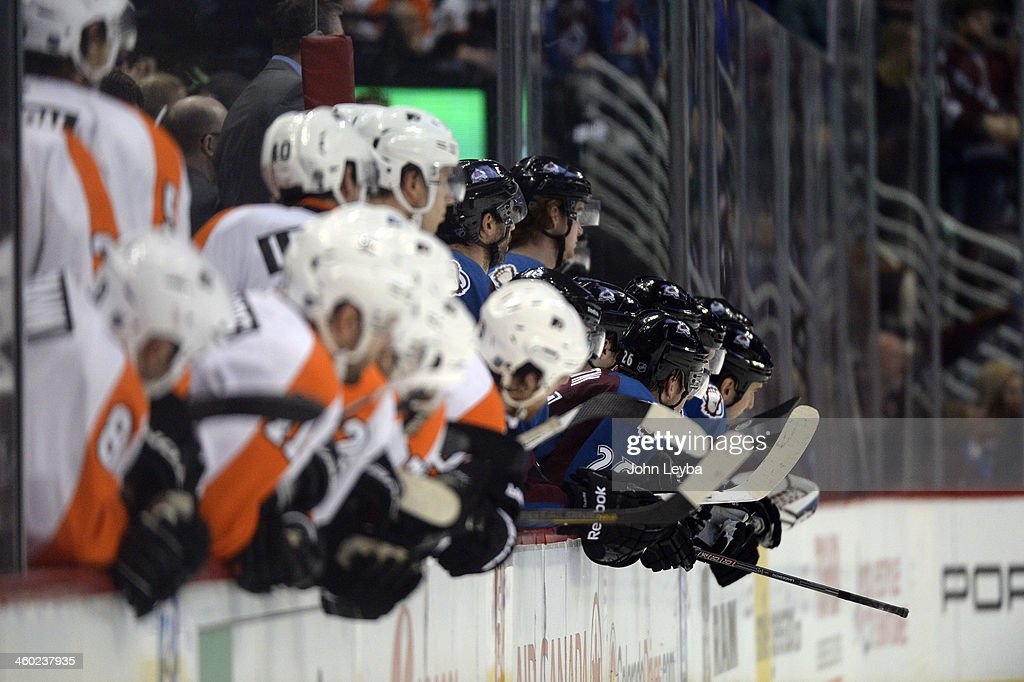 Colorado Avalanche and the Philadelphia Flyers lean over to watch during the third period January 2, 2014at Pepsi Center.