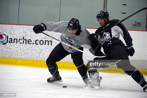 Colorado Avalanche C Joseph Blandisi battles for the puck with D Duncan Siemens during rookie camp practice September 10 2013 at Family Sports The...