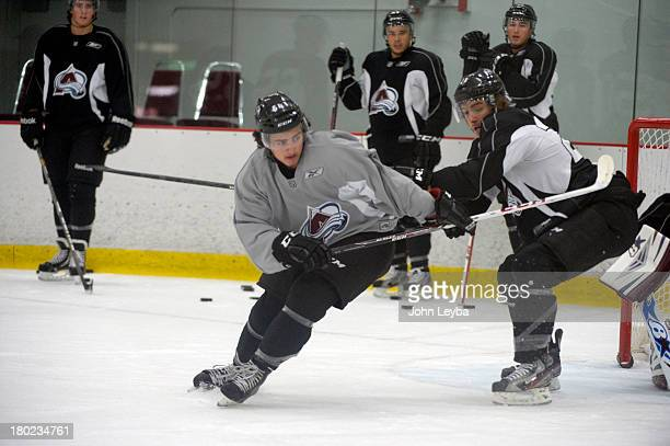 Colorado Avalanche C Joseph Blandisi battles with D Duncan Siemens in front of the net during rookie camp practice September 10 2013 at Family Sports...