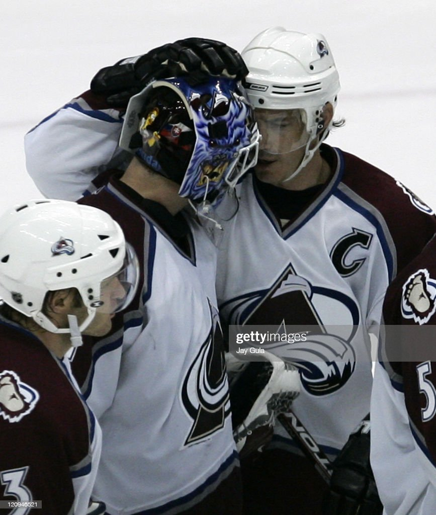 Colorado Avalanche captain <a gi-track='captionPersonalityLinkClicked' href=/galleries/search?phrase=Joe+Sakic&family=editorial&specificpeople=202869 ng-click='$event.stopPropagation()'>Joe Sakic</a> #19 congratulates goaltender Peter Budaj #31 after he backstopped the team to a 4-1 victory over the Toronto Maple Leafs at the Air Canada Centre in Toronto, Canada. October 18, 2006 .