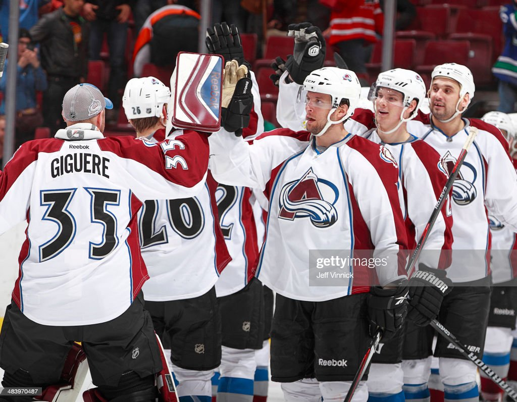 Colorado Avalanche celebrate a victory over the Vancouver Canucks after their NHL game against the Vancouver Canucks at Rogers Arena April 10, 2014 in Vancouver, British Columbia, Canada. Colorado won 4-2.