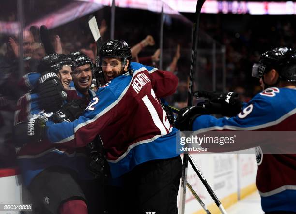 Colorado Avalanche center Alexander Kerfoot celebrates his goal with right wing Nail Yakupov and defenseman Patrik Nemeth in the first period against...