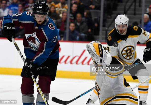 Colorado Avalanche center Alexander Kerfoot deflects a shot past Boston Bruins goalie Tuukka Rask for a goal in the first period October 11 2017 in...