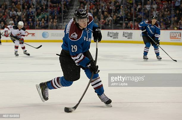 Colorado Avalanche center Nathan MacKinnon takes a shot on goal during the overtime against the New Jersey Devils January 16 2014 at Pepsi Center Th...