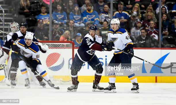 Colorado Avalanche center Tyson Jost matches up with St Louis Blues center Ivan Barbashev during the first period on March 31 2017 in Denver Colorado...
