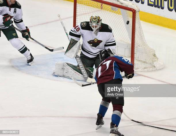 Colorado Avalanche center Tyson Jost scores his first NHL goal against Minnesota Wild goalie Devan Dubnyk in the second period at the Pepsi Center...