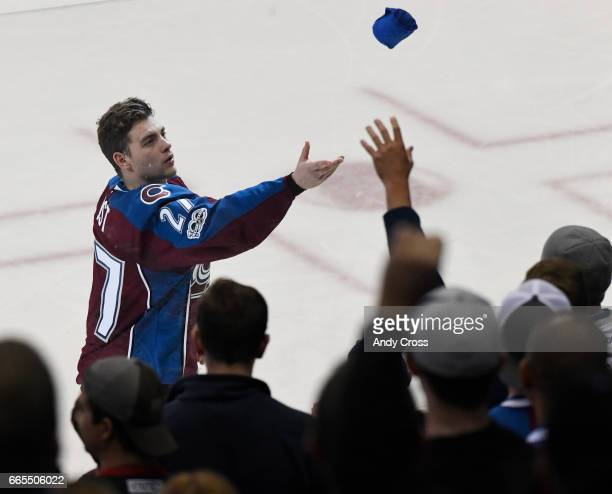 Colorado Avalanche center Tyson Jost tosses a tshirt to the fans after the last home game of the season against the Minnesota Wild at the Pepsi...