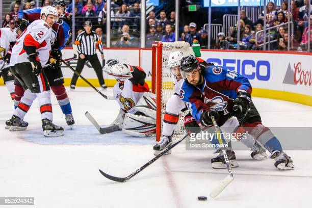 Colorado Avalanche Defenseman Mark Barberio skates with the puck as Ottawa Senators Defenseman Chris Wideman defends during the Ottawa Senators and...