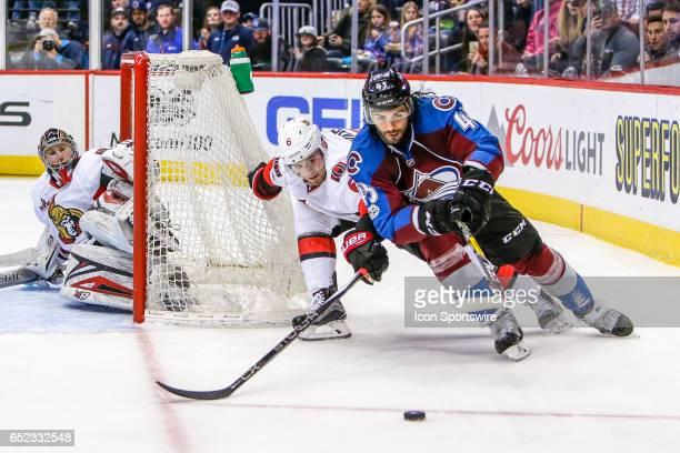 Colorado Avalanche Defenseman Mark Barberio tries to control the puck as Ottawa Senators Defenseman Chris Wideman defends during the Ottawa Senators...