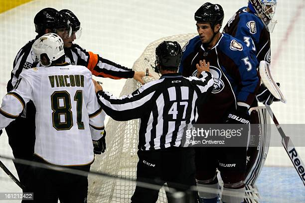 Colorado Avalanche defenseman Shane O'Brien and Dallas Stars center Tomas Vincour are separated after they began jawing following a dispute in the...