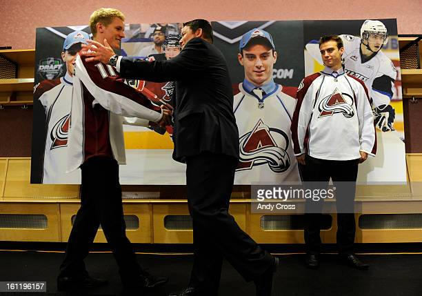 DENVER CO Colorado Avalanche Director of Amateur Scouting Rick Pracey center greets newly drafted Avalanche player Gabriel Landeskog left during a...