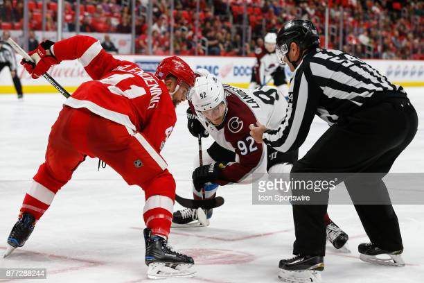 Colorado Avalanche forward Gabriel Landeskog of Sweden and Detroit Red Wings center Luke Glendening wait for the puck to be dropped during a faceoff...
