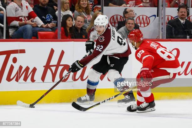 Colorado Avalanche forward Gabriel Landeskog of Sweden skates with the puck against Detroit Red Wings defenseman Trevor Daley during a regular season...