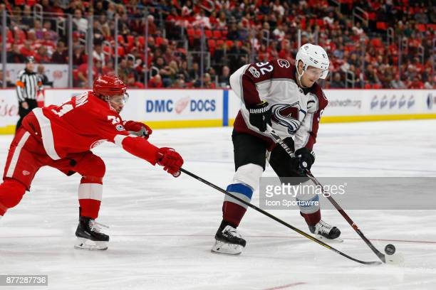 Colorado Avalanche forward Gabriel Landeskog of Sweden skates with the puck against Detroit Red Wings center Dylan Larkin during the third period of...
