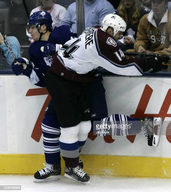 Colorado Avalanche forward Ian Laperriere checks Toronto's Alex Steen into the boards in NHL action vs the Toronto Maple Leafs at the Air Canada...