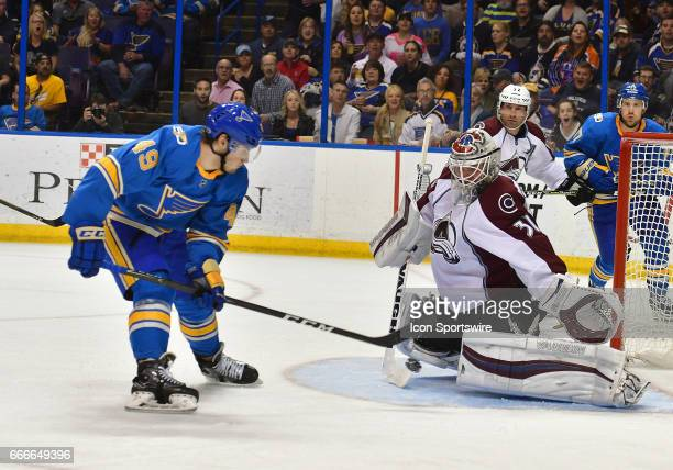 Colorado Avalanche goalie Calvin Pickard blocks a shot by St Louis Blues center Ivan Barbashev during an NHL game between the Colorado Rockies and...