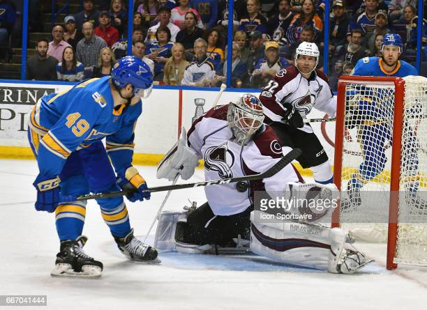 Colorado Avalanche goalie Calvin Pickard blocks a shot by St Louis Blues center Ivan Barbashev during an NHL game between the Colorado Avalanche and...