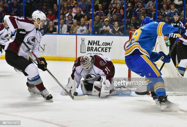 Colorado Avalanche goalie Calvin Pickard covers the puck after a shot by St Louis Blues center Ivan Barbashev during an NHL game between the Colorado...